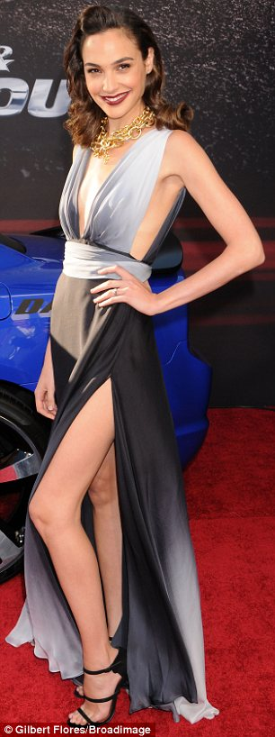The thigh's the limit: Gal Gadot's dress was floor-sweeping but she showed lots of skin with a plunging neckline and split all the way up to the top of her leg