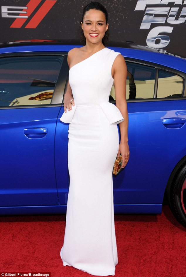 Like a glove: Michelle's floor-length peplum dress was also sexy thanks to its form-fitting nature