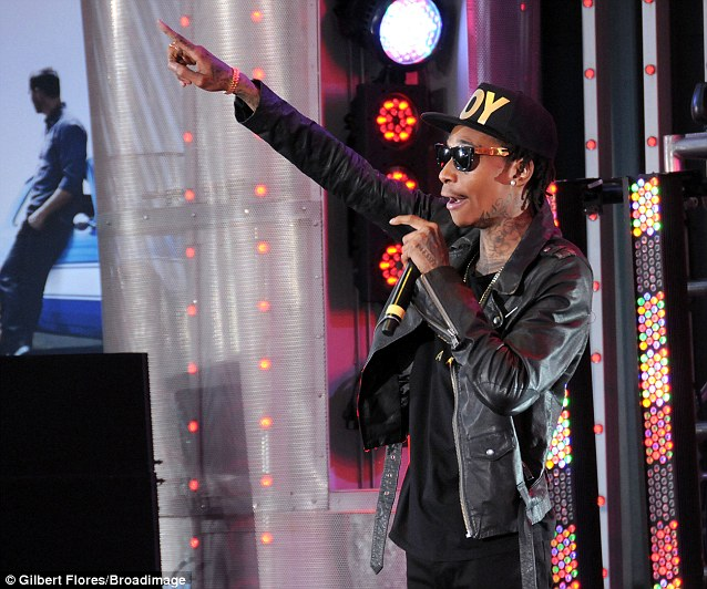 Put your hands up: Wiz Khalifa took to the stage to address the crowd during the event