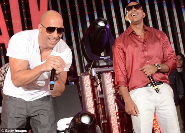 Taking the stage: Ludacris performed for the crowd at the event, and spent some time on stage with Vin Diesel