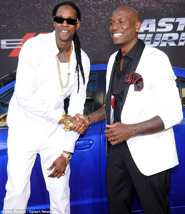What a treat: 2 Chainz, seen here with Tyrese Gibson, was another star to perform at the premiere