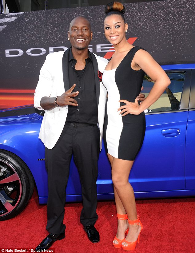 A perfect match: Tyrese and his better half couldn't choose between black or white so picked both
