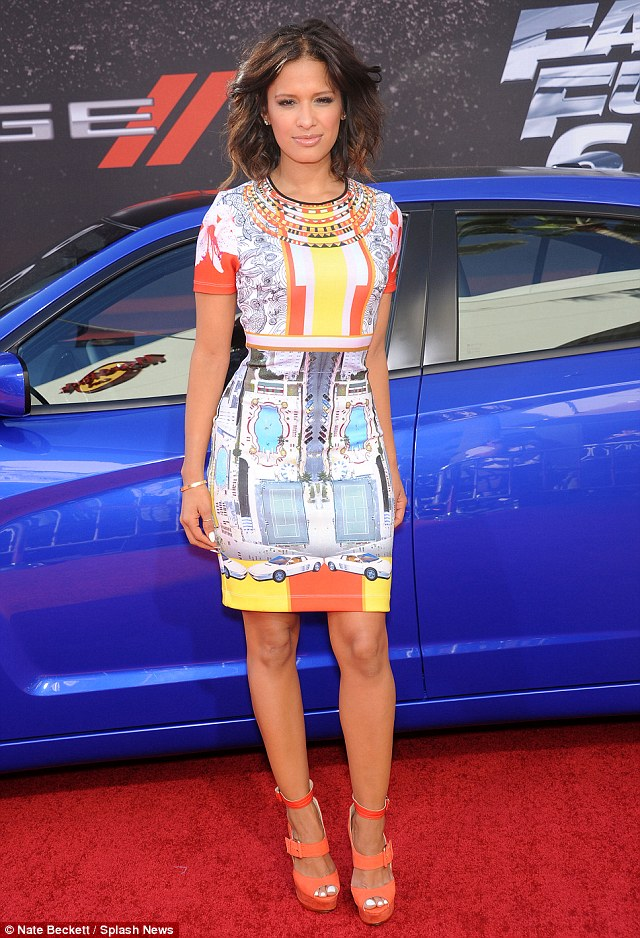 Vibrant hues: Rocsi Diaz showed off her curves in a figure-hugging colourful dress paired with orange strappy heels