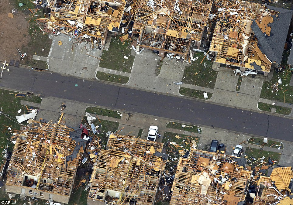 Roofs missing: This Tuesday, May 21, 2013 aerial photo shows homes damaged by Monday's tornado in Moore, Oklahoma