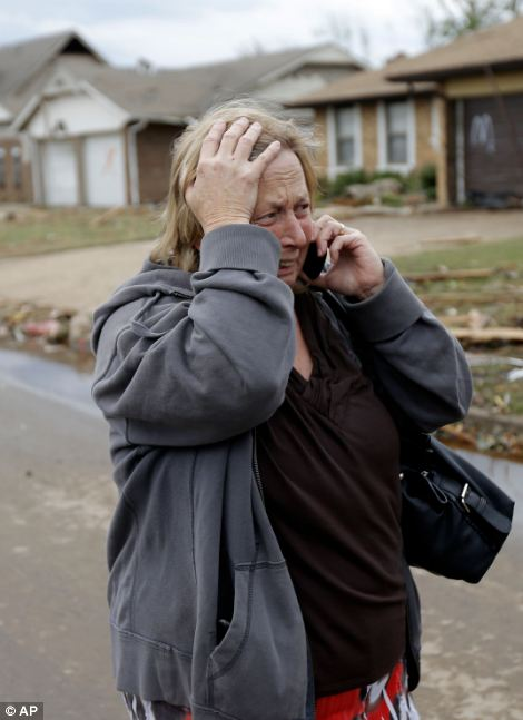 Paula McGee reacts as she sees her home on Kings Manor in Moore, Okla., on Tuesday, May 21, 2013. McGee bought the home two weeks ago