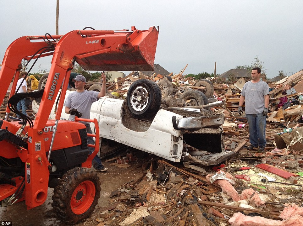 Rubble: People start clearing debris in the 2100 block of SE 5th in Moore Tuesday, May 21, 2013 after a massive tornado went through the area Monday
