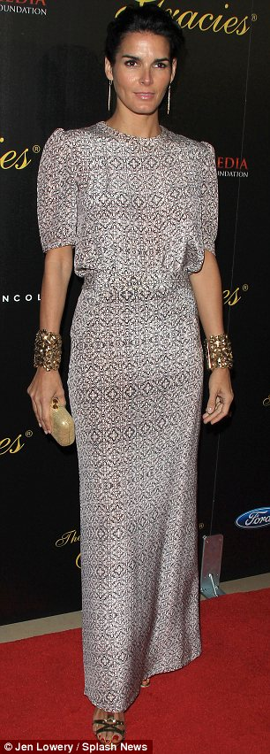 Glamorous gowns: Angie Harmon (L) and Meg Tilly both went all-out for the occasion in floor-length dresses