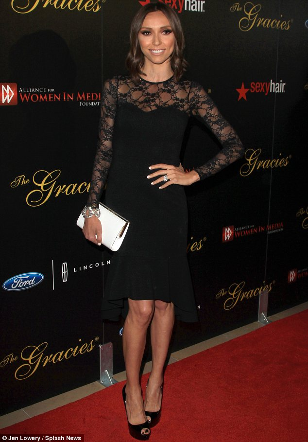 Lovely in lace: Giuliana Rancic, whose reality show scooped an award, dressed her slender figure in a black lace dress