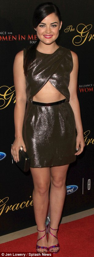 Hot metal: Lucy Hale showed off her toned midriff in a cut-out bronze dress at the Gracie Awards gala in Beverly Hills on Tuesday