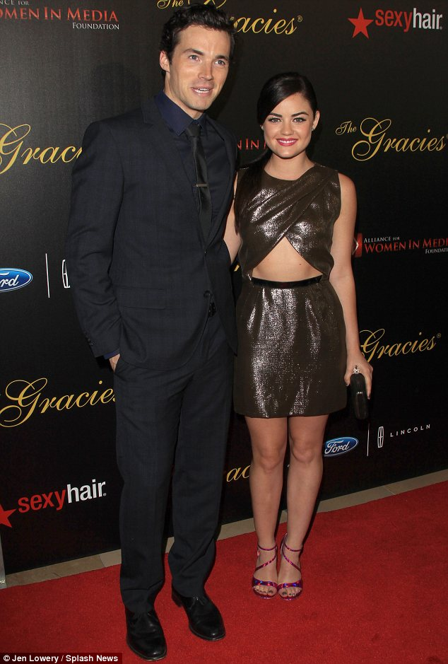 Sweet touch: Lucy was presented the award by co-star and on-screen love interest Ian Harding