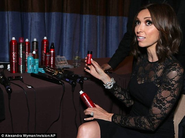 Giuliana Rancic obsessing over her favorite Sexy Hair product, the ?Powder Play?, in the Sexy Hair beauty lounge at The Gracie Awards