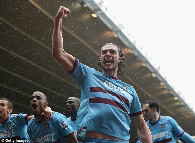 Return: The news that Carroll faces a lengthy lay-off will not affect his £15million permanent deal