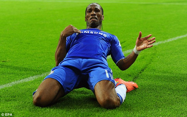 Kneesy does it: Drogba celebrates his equaliser against Munich