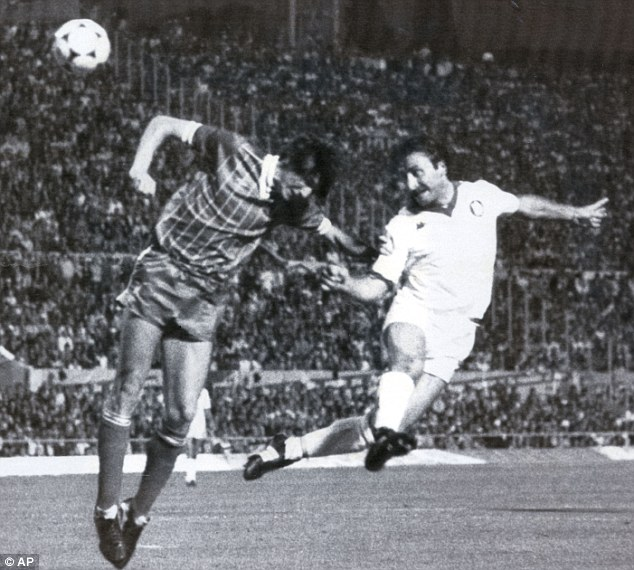 Heads I win: Roberto Pruzzo beats Liverpool's Alan Hansen to the ball to equalise for Roma