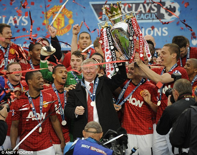 Celebration: Sir Alex Ferguson, pictured here lifting Manchester United's 20th league title earlier this month, won 38 trophies during 26 years with the club