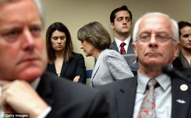 The great escape: Lerner leaves the Oversight Committee hearing room as members sparred over whether she could read an opening statement and then refuse to testify