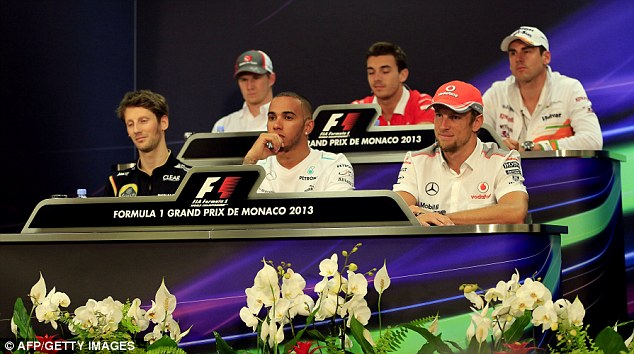 Falling out: Lewis Hamilton (front centre) shared the Monaco press conference with Adrian Sutil (top right)