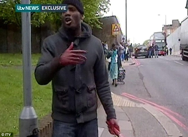This exclusive still from a video obtained by ITV News shows a man with bloodied hands and carrying knives speaking to a camera in Woolwich, south-east London