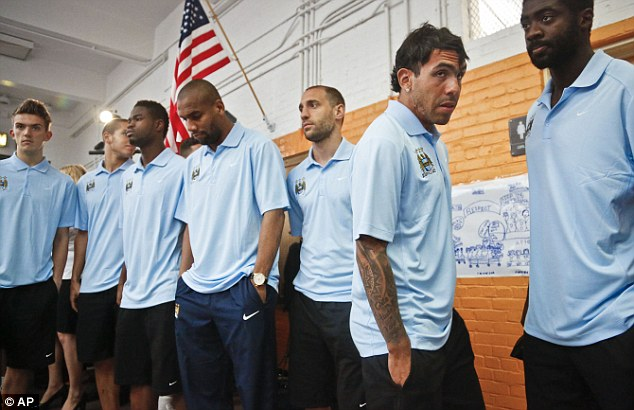 The waiting game: City stars arrive for their press conference