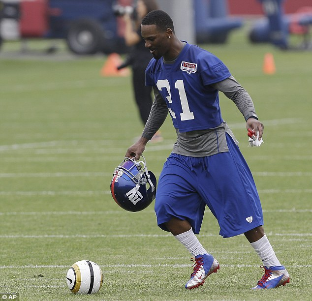 Any good? New York Giants' Aaron Ross tries the English equivalent of football