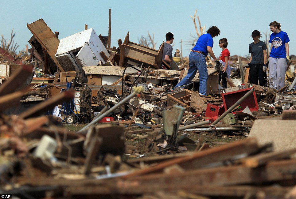 Heartbreak: The massive tornado flattened thousands of residents' homes when it roared through the Oklahoma City suburb on Monday