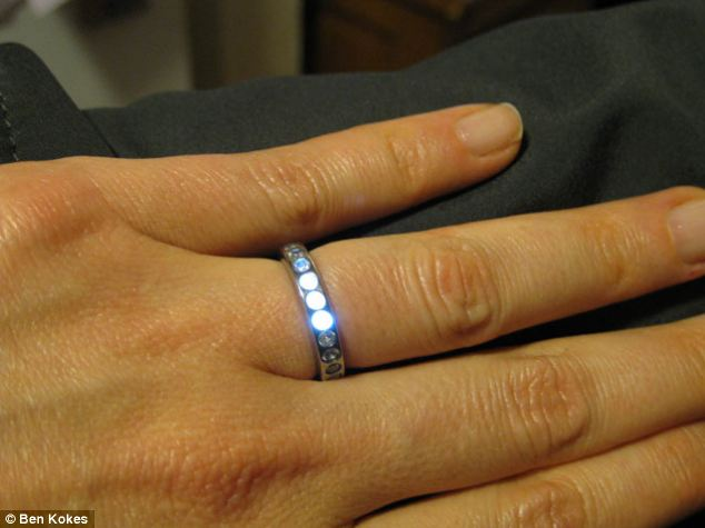 The glowing ring contains tiny LEDs which light up when a transmitted is nearby - and took five months to build.