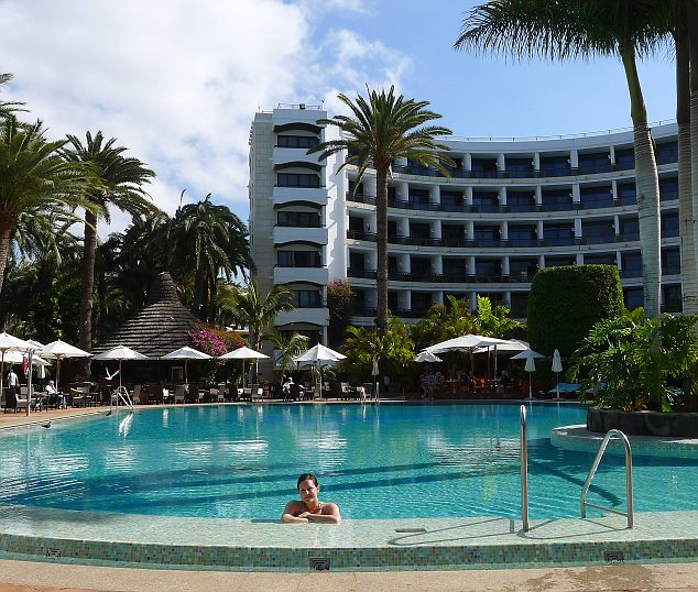 Pre-baby bliss: Emily enjoys the peaceful pool at the Seaside Palm Beach hotel in Maspalomas