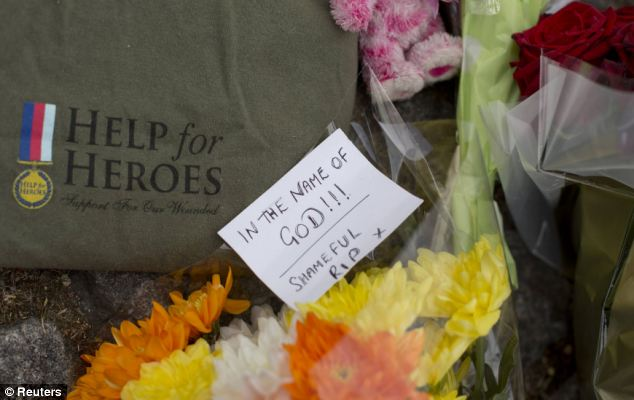Floral tributes, and a T-shirt, have been left outside the Royal Military Barracks, near the scene where a solider was brutally murdered in broad daylight