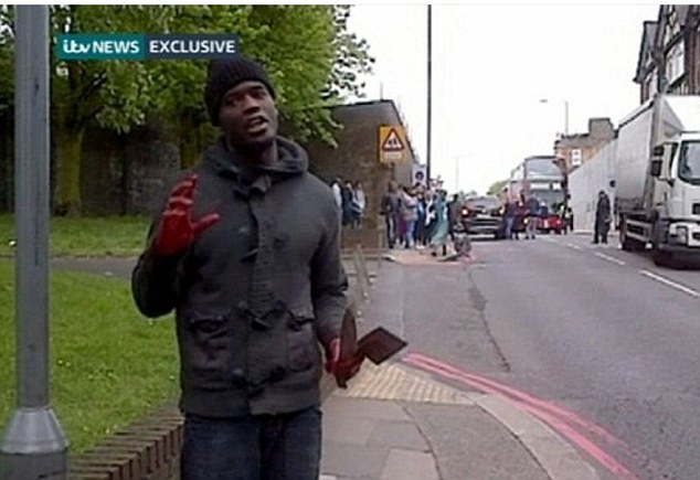 Footage has emerged of a man with bloodied hands carrying what appears to be a knife and a machete