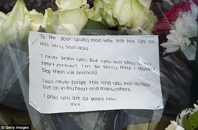 Attached to a bunch of white roses, the neatly written note is from a person who didn't know the victim but felt moved to visit where he died