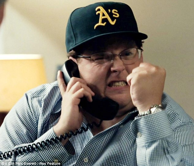 Happier and healthier: Jonah lost 40 pounds after starring in baseball movie Moneyball with Brad Pitt