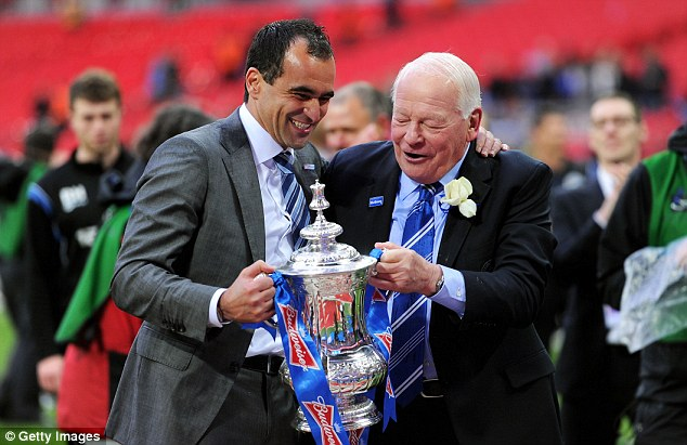 Chuffed with the cup: Martinez with chairman Dave Whelan after beating Manchester City in the FA Cup final