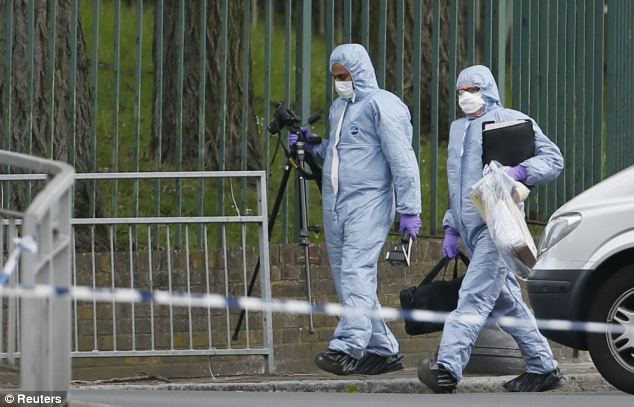 Forensics teams were pictured this morning scouring the area around the scene of the killing
