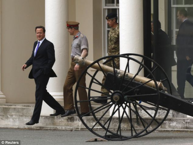 David Cameron this afternoon met with military officials as he visited an army barracks in Woolwich near the scene of the killing