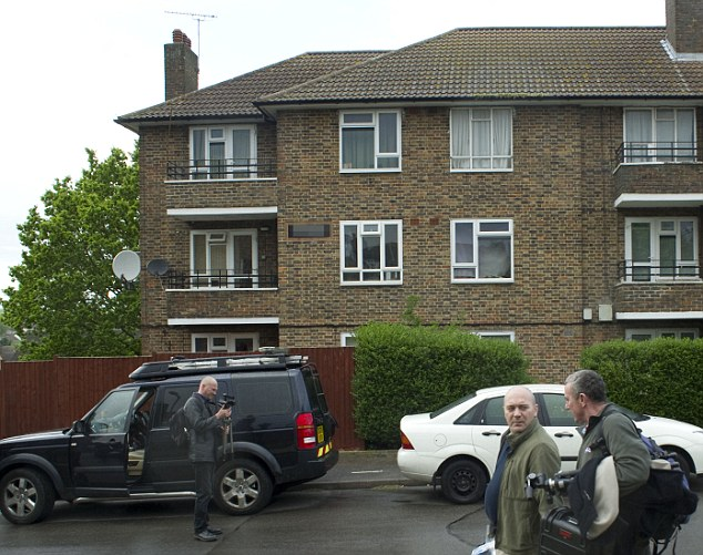 A block of flats in Harold Hill, Essex, where police and forensics staff searched a top floor home