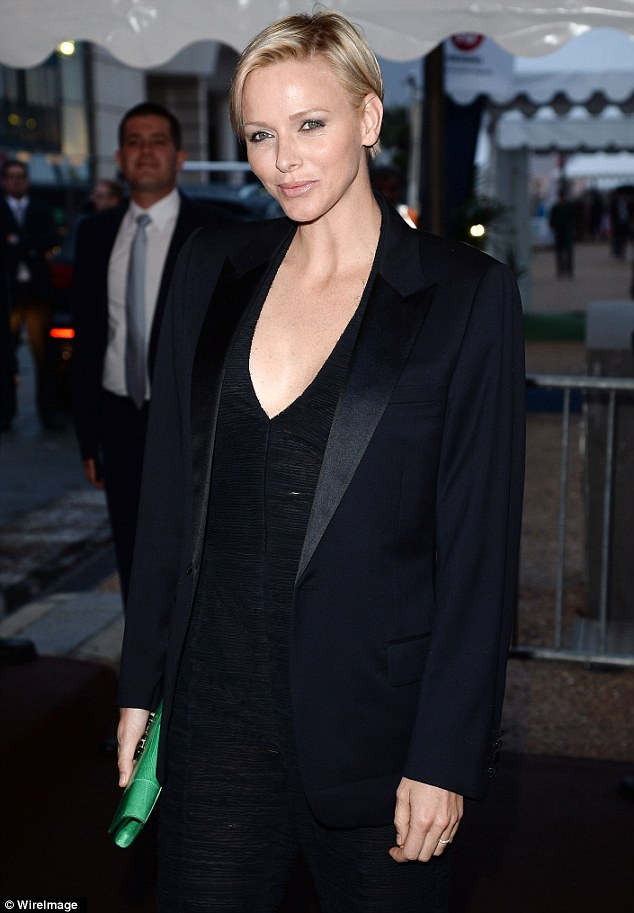 Joining the party: Princess Charlene of Monaco looked ecstatic on Wednesday evening as she joined the A list stars aboard Roberto Cavalli's yacht party in Cannes