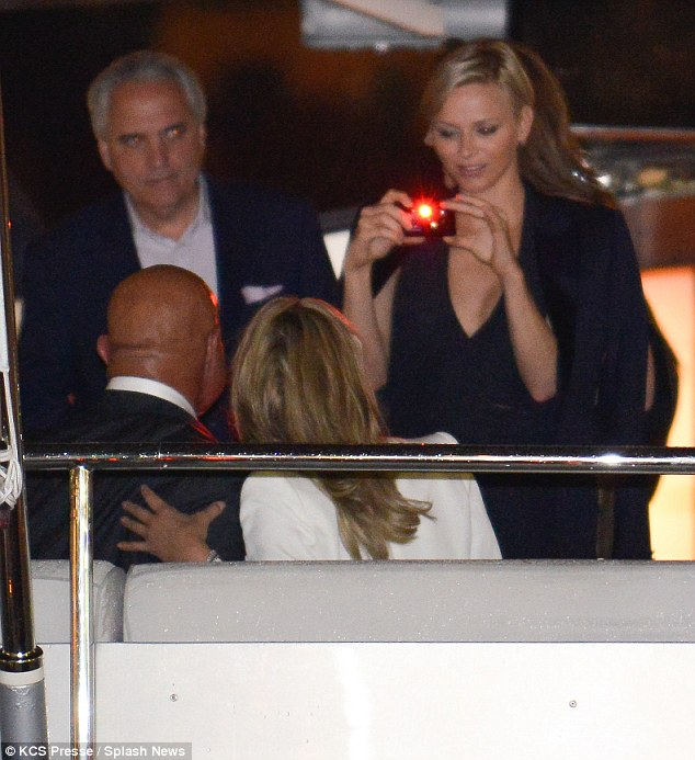 Making friends: Charlene even spoke to Hollywood star Sharon Stone and took photos of her during the yacht party