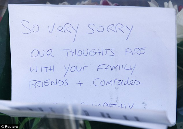 Tribute: A handwritten note left with a bouquet of flowers near the scene of the killing in Woolwich