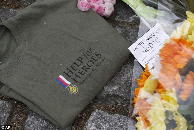 Honour: A Help for Heroes t-shirt which was left at the scene yesterday. The soldier was wearing one of the charity's tops when he was brutally murdered