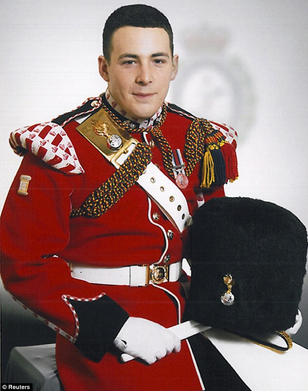 Fallen hero: Father Lee Rigby, 25, from Manchester, was described as 'cheeky and humorous' in tributes. He was executed by two suspected Islamic terrorists in Woolwich on Wednesday afternoon