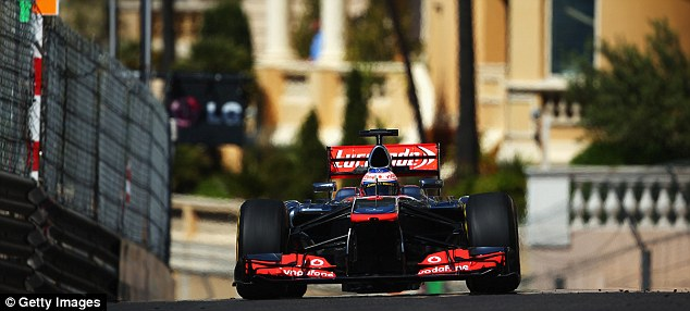 British challenge: Lewis Hamilton (above) and the McLaren of Jenson Button (below)