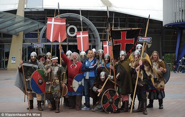 Viking invasion: Kessler poses outside the O2 with viking raiders