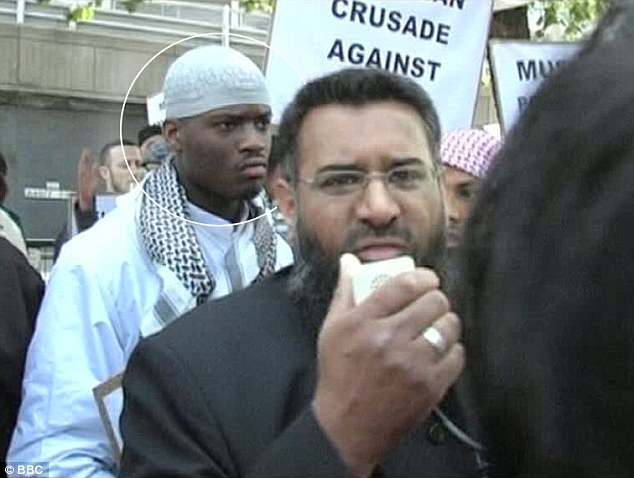 Terror suspect: Anjem Choudary (right) claimed that this is him pictured with Michael Adebolajo, 28, (circled) at an Islamist demonstration in London in 2007