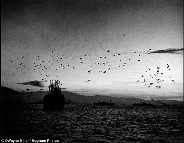 This image taken in 1944, shows US Navy ships firing anti-aircraft guns. Famed fashion photographer Edward Steichen picked him to help document the war
