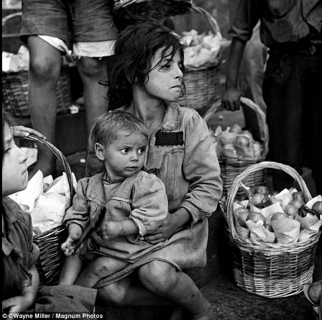 This image, shows children sitting in the streets of Naples, Italy, July, 1944