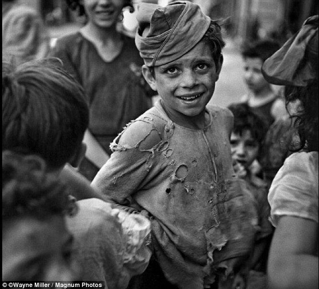 A poignant image of a boy in dirtied and torn clothes in Naples, July, 1944. But Miller had originally trained for a career in banking