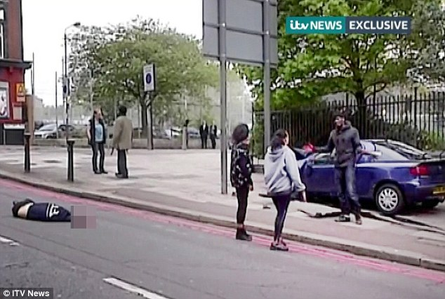 Angels of Woolwich: Gemini Donnelly-Martin, 20, and her mother Amanda (right) talk to Adebolajo while Ingrid Loyau-Kennett (left) talks to the Adebowale as Lee Rigby lies dead in the road