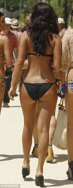 From full to pert: Lucy's derriere also looks noticeably smaller than her 2011 holiday