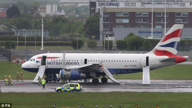 The plane was surrounded by emergency vehicles after it made the emergency landing this morning