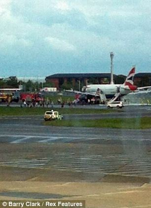 The plane with emergency services surrounding it after it landed at Heathrow this morning